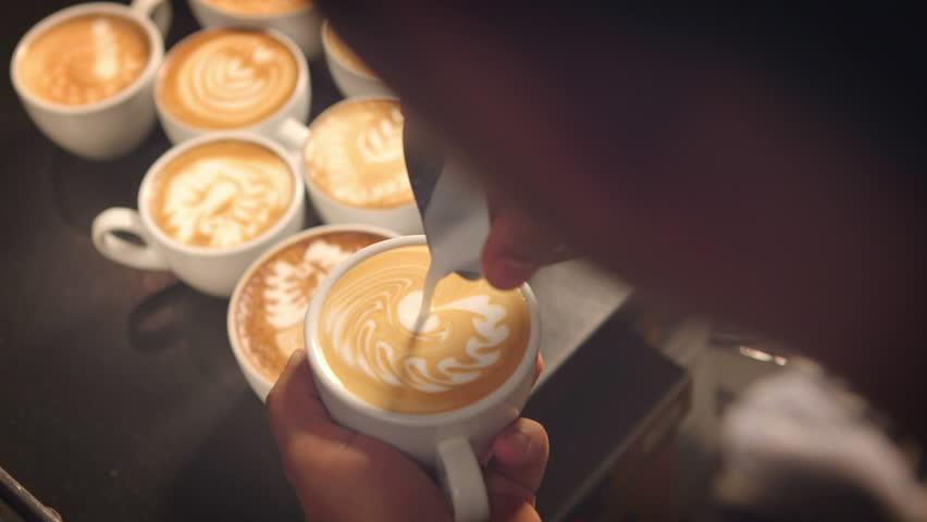 Barista prepares latte in take away cup