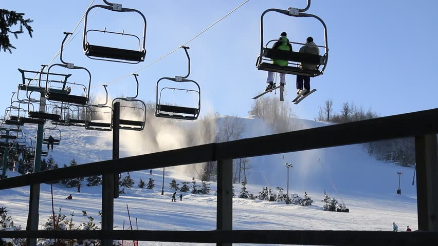 Blue Mountain, Ontario/Canada - January 14, 2015: Ski lifts with unrecognizable people and skiers in Blue Mountain Village, Collingwood, Ontario, Canada