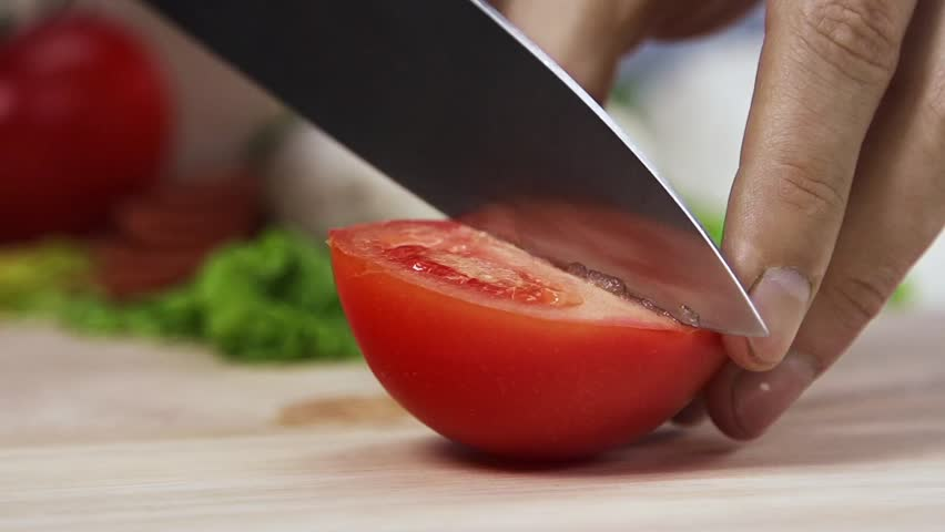 Nice and neat cut tomatoes, healthy food, SLOW MOTION - HD stock footage clip