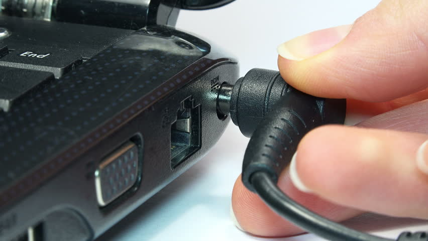 Close-up View of Woman Insert Laptop Battery Charge. 4K Ultra HD 3840x2160 Video Clip