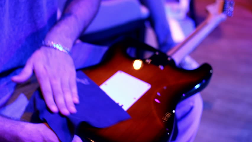 backstage: guitarist preparing electric guitar before the show - HD stock video clip
