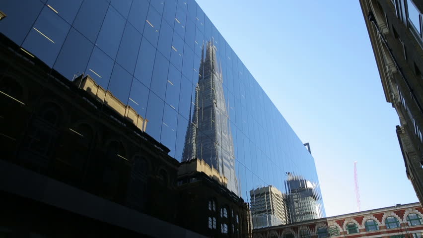 the shard London reflecting in tall building next to the shard at London Bridge Station #8570938