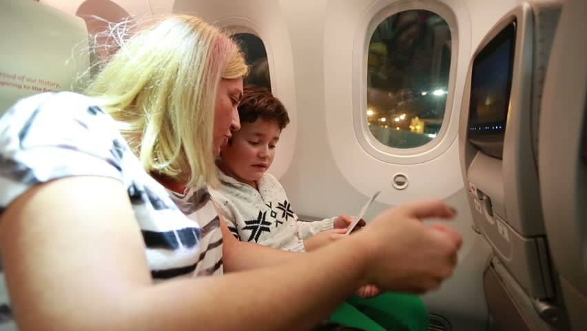 kid with mom in plane