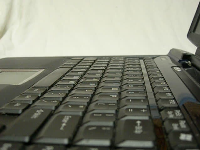 Typing on laptop keyboard - SD stock video clip