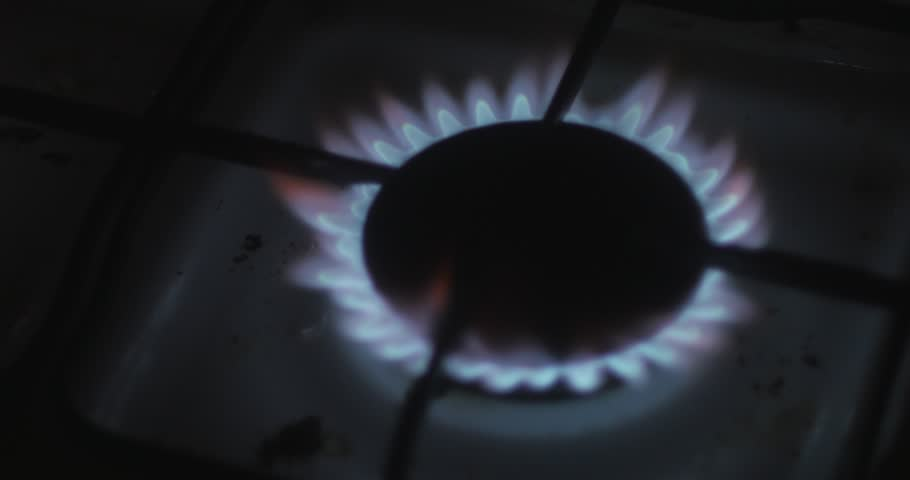 Gas burner stove for cooking, yellow and blue flames, burning gas, paper. The use of oxygen gas is burning, a large flame. The fire in the kitchen burning room. Set fire Night dark  flash fire. - 4K stock footage clip
