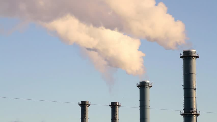 Smoke from factory over blue sky. Industrial pollution. - HD stock video clip