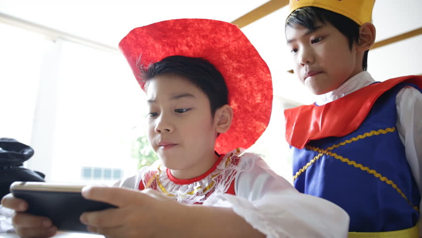 Asian children using a digital tablet together . | Shutterstock HD Video #8609251