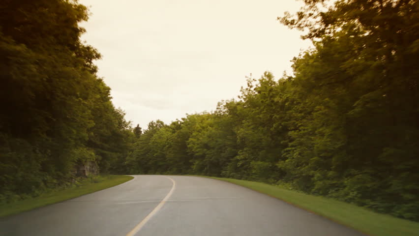 Long curve on a beautiful rural road. Color adjusted to give a romantic and dreamy look.