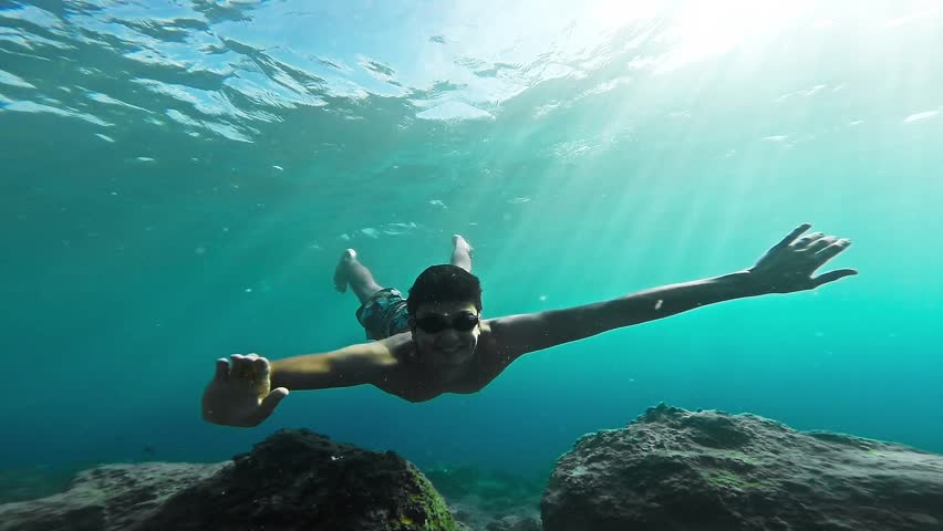 Young Athletic Diver Underwater Shot Wildlife Fish Sunlight Beauty Coral Reef Vacation Relaxation Exploration Adventure Hobby Snorkel Nature Gopro HD