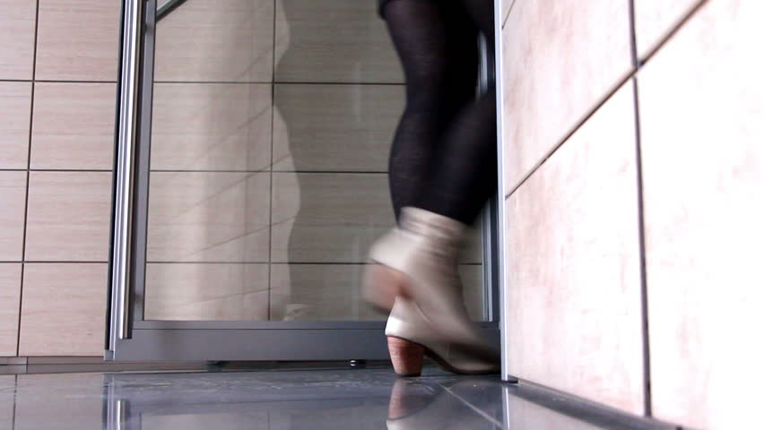 Woman feet getting out through a glass door with effective design #8645809