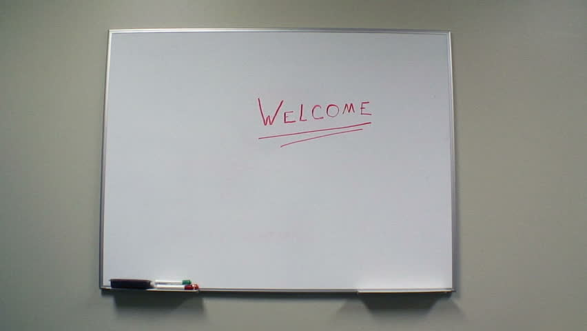 Teacher walks on camera ,looks at the welcome on the board and turns to greet the class | Shutterstock HD Video #86467
