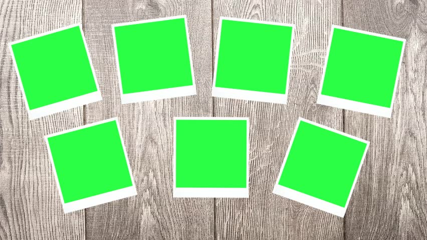 Photos with a green screen on a wooden background | Shutterstock HD Video #8670883