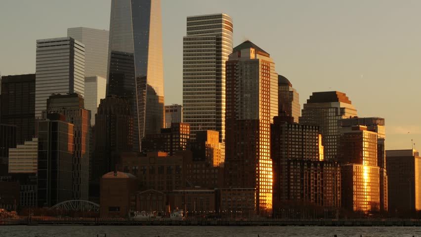 Cityscape panorama view at sunset magic hour light. modern high rise buildings   Shutterstock HD Video #8700205