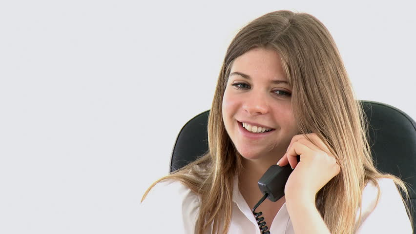 young female executive on phone sitting in the office - HD stock footage clip