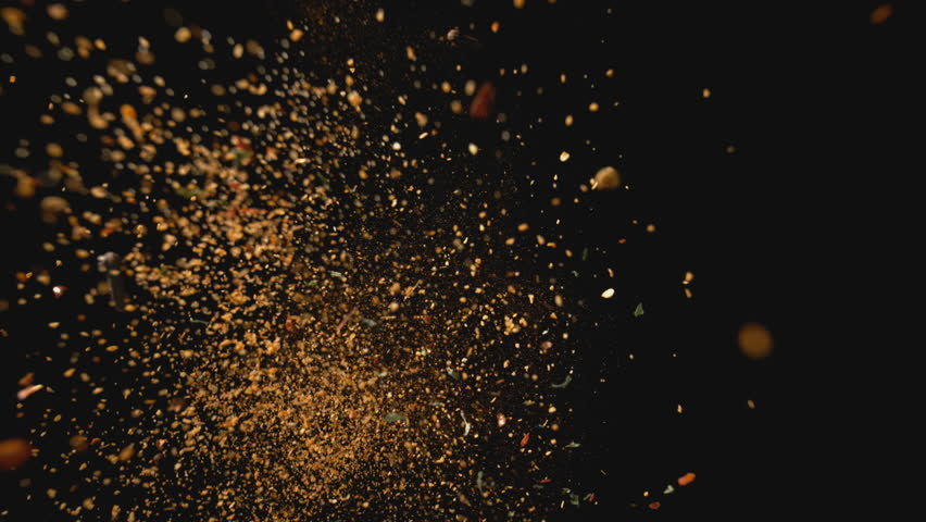 Camera follows spices flying after being exploded against white background. Slow Motion. Shot with high speed camera, phantom flex 4K. Slow Motion. Unedited version is included at the end of clip.