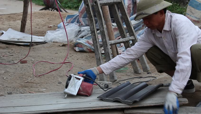 HAI DUONG, VIETNAM, January, 12: construction workers in the field.  - HD stock footage clip