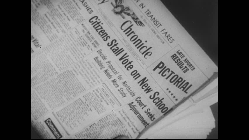 UNITED STATES 1950s: View of newspaper / Dissolve to text on paper, hands edit text. - HD stock footage clip