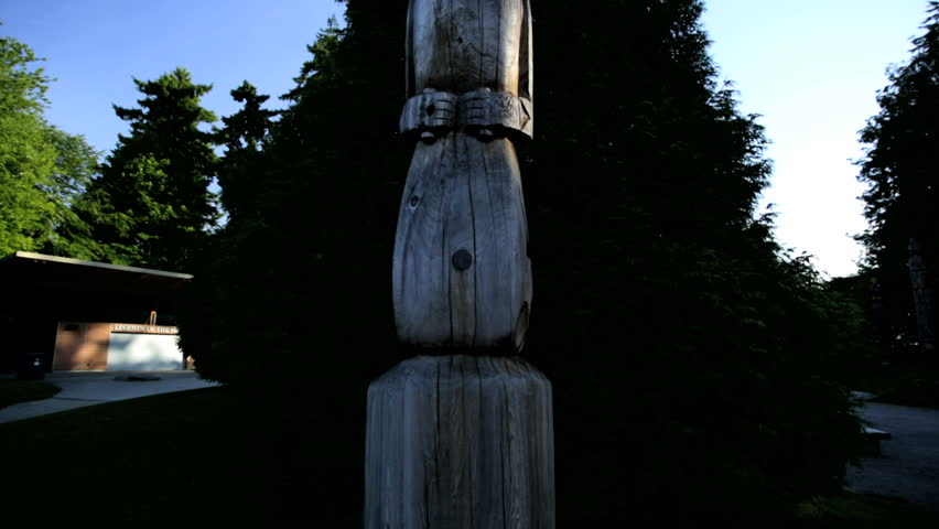 Traditional Indigenous Indian Totem Pole Thunderbird Park Vancouver City religious carvings handcrafted First Nation Canada - HD stock footage clip