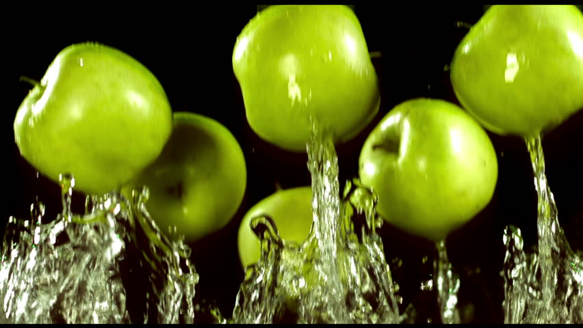 Apples in a spray of water on a black background, slow motion   Shutterstock HD Video #8738473