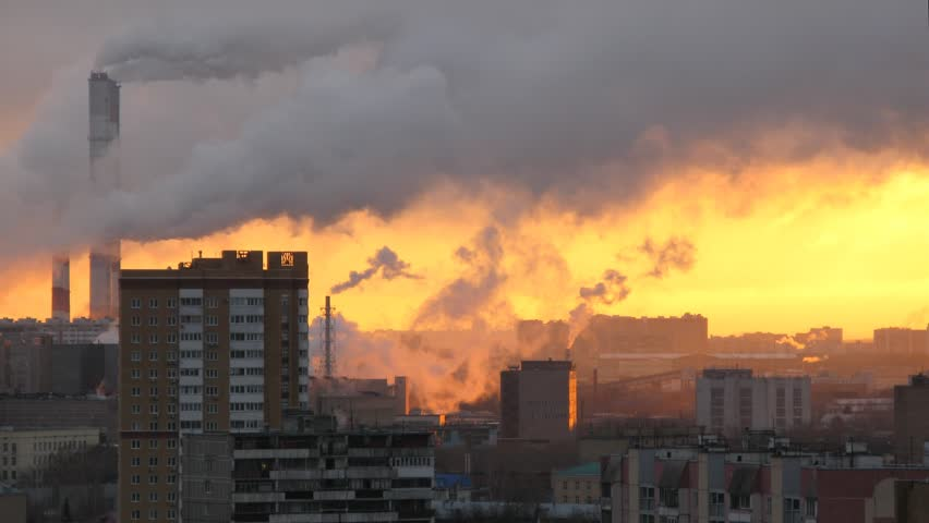 View of a modern district with pipes factories, of which there is smoke at sunrise. Time lapse. #8744251