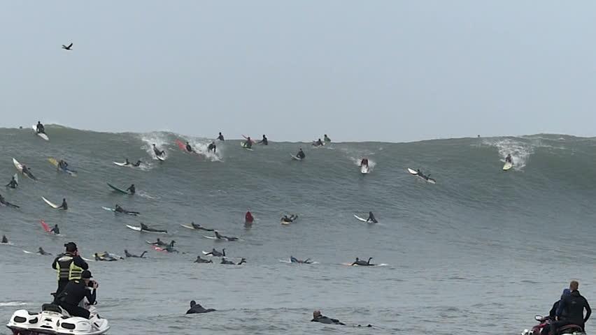 Half Moon Bay, California, USA - Dec. 20, 2014: Big wave surfer, Joshua Ryan, falls while riding a giant wave at Mavericks surf break.