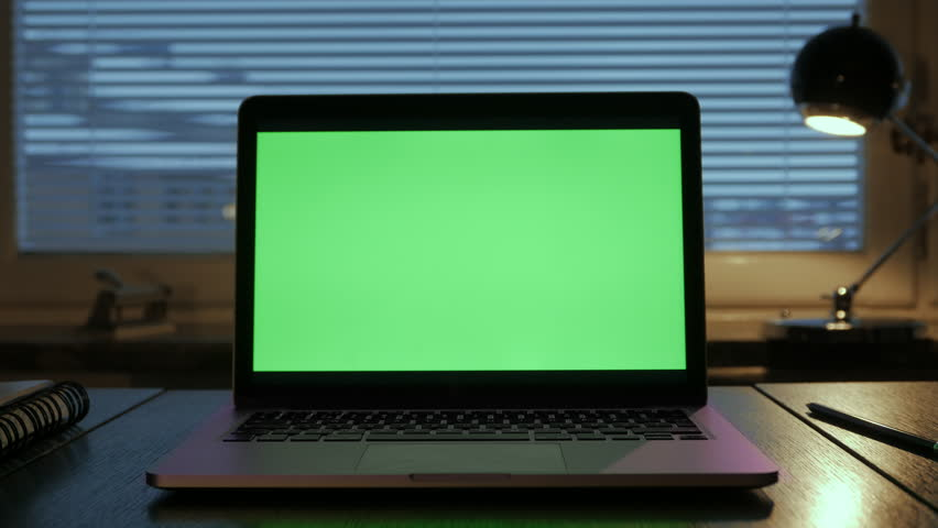 Laptop screen (Green Screen), Medium shot, in Home Office.