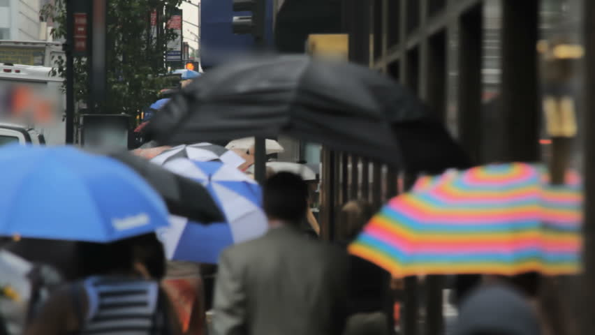 Defocused crowd - people with umbrellas, New York City