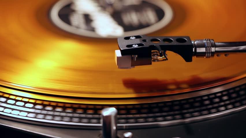 Gramophone record with orange vinyl, close-up .