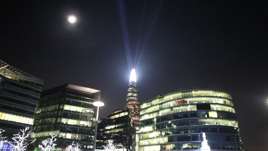 LONDON - DEC 31 2014: London skyline on Thames river with Shard in the background. Completed in 2012, it is the tallest building in the European Union. time lapse view,4k - HD stock video clip