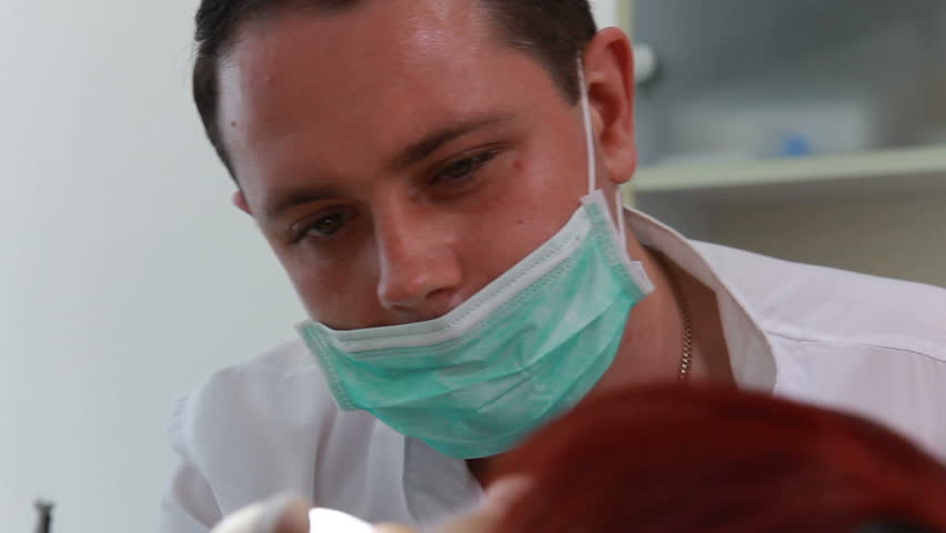 Stomatology - Dentist in the work (dolly shot, close up) - HD stock video clip