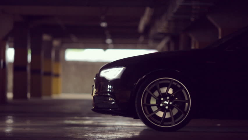Black Audi leaves the parking lot with its lights on HD 1080p