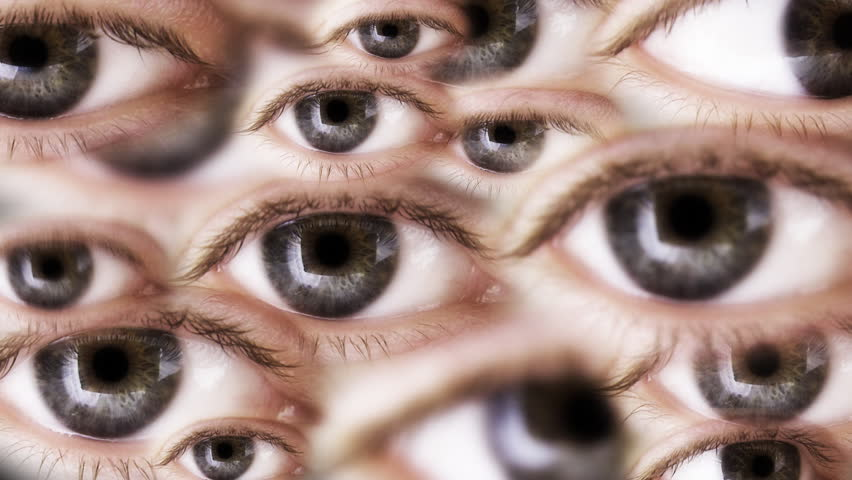 Multiple eyes are looking. Seamless loop. Depth of field.