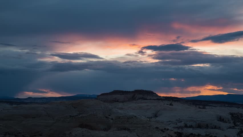 Time lapse colorful sunset clouds in the red rock desert of Utah.