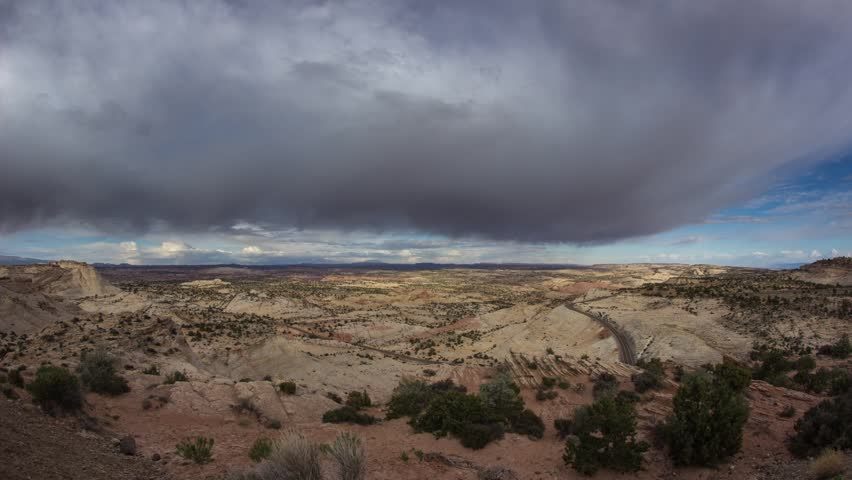 Time lapse of clouds moving above in Utah desert on a sunny day in Utah desert, United State