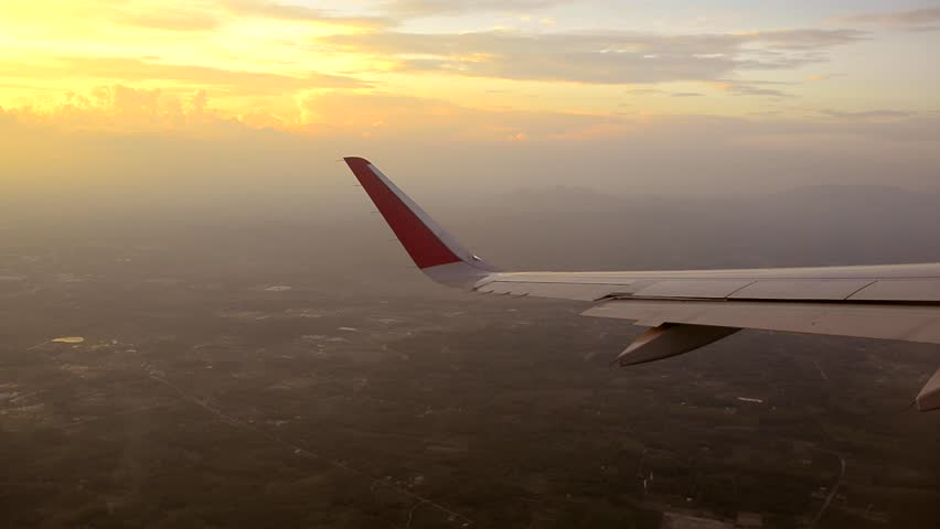 Plane wing window sky sunset | Shutterstock HD Video #8831578