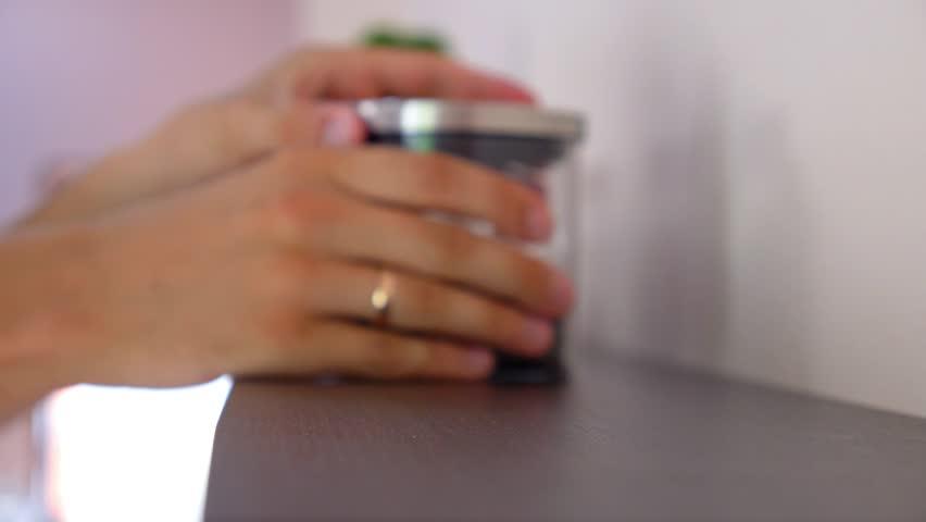 Putting Jars with Tea on a Shelf. HD, 1920x1080. - HD stock footage clip