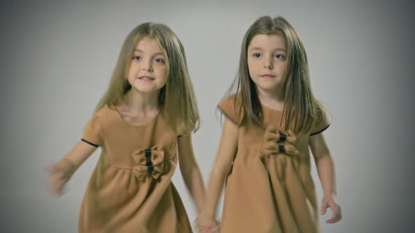 Good looking and loving twins. Sisters. Walking, Smiling, Playing. Adorable. Happy lifestyle kids.   Shutterstock HD Video #8885155