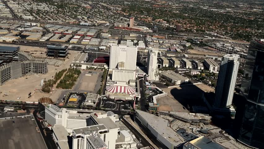 Aerial of the Las Vegas Strip, Internationally known for the concentration of resort hotels and casinos along its route. One of the most popular destinations for tourists in the USA, and the world. - HD stock footage clip