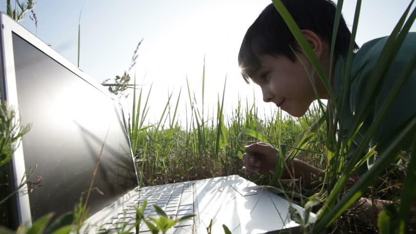 boy and  laptop.  nature. Summer.  green grass - HD stock footage clip