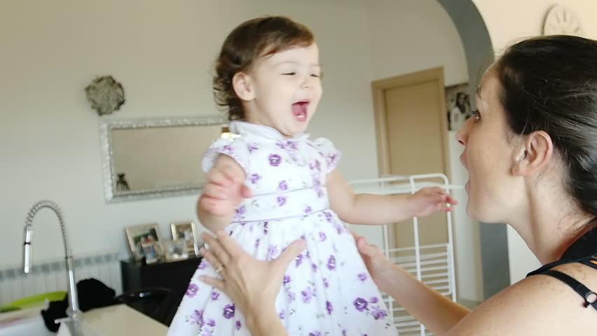 mother loving her child: hugs, games, tenderness in a lovely family