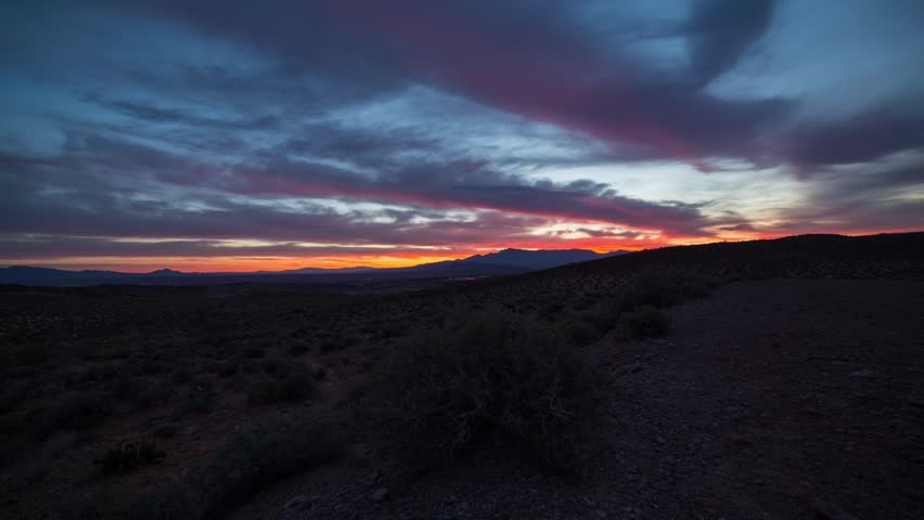Time lapse sunrise in the Nevada desert with clouds movement. Clouds moving over Valley of Fire State Park on a cloudy morning with vibrant colour in the Nevada Desert