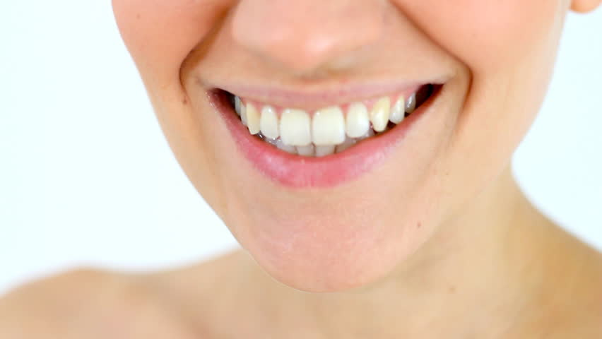 Smiling woman mouth, isolated - HD stock video clip
