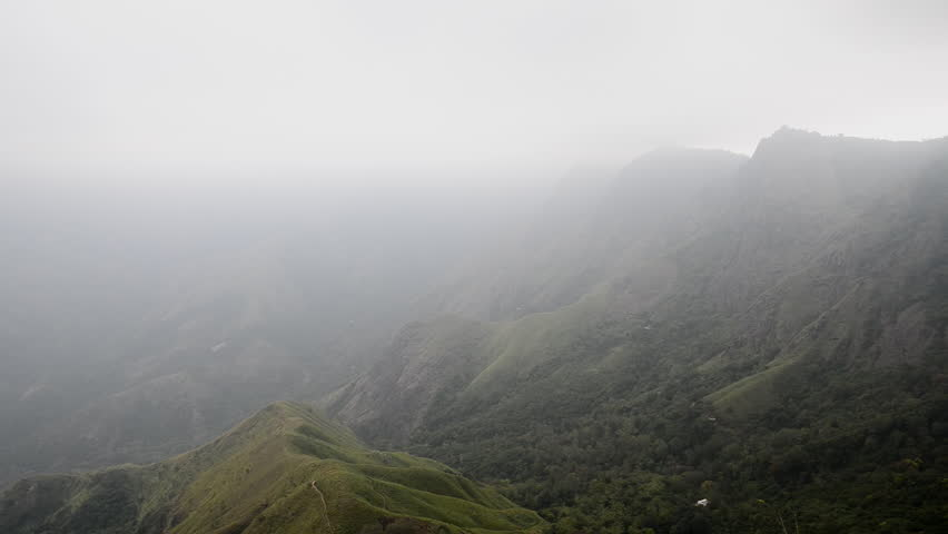 Mountains of Indian Western Ghats in Kerala. Pan left. - HD stock footage clip