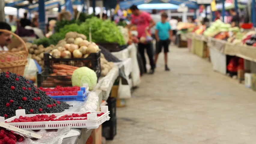 View of a traditional marketplace with fresh farm fruits and organic vegetables.