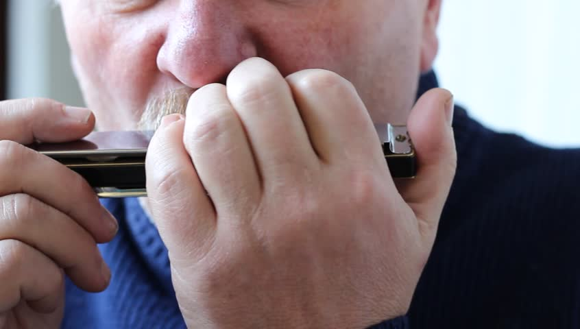 The harmonica, also French harp, blues harp, and mouth organ, is a free reed wind instrument used worldwide in nearly every musical genre, notably in blues,  jazz, country, and rock and roll.