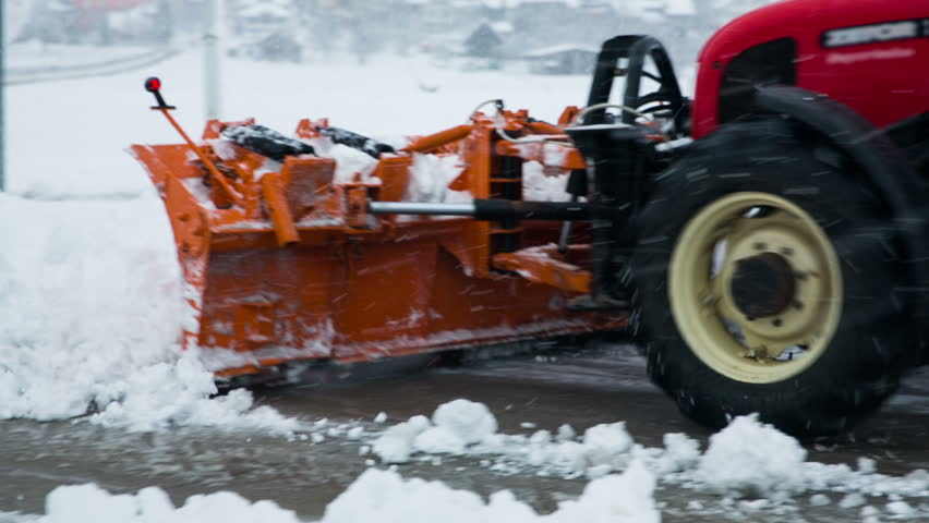 Removing snow with plow. Close up of iron snowplow pushing a lot of snow away. - HD stock footage clip