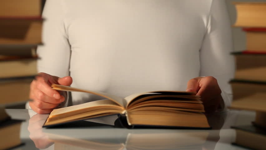 Hands and book  - HD stock video clip
