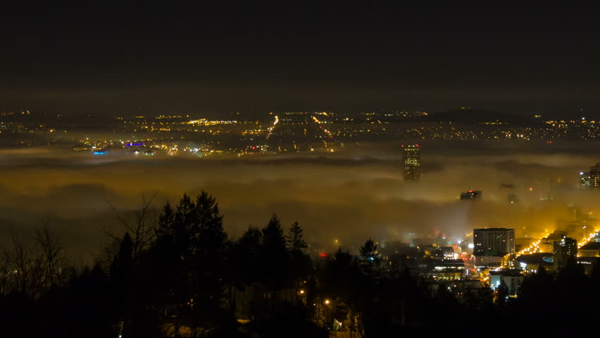 Panning Time Lapse Movie of Thick Dense Rolling Fog Over Downtown City of Portland Oregon with Snow Covered Mount Hood One Early Winter Morning at Sunrise 1080p. - HD stock footage clip
