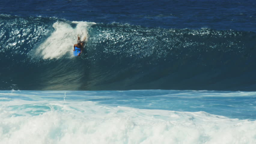 HALEIWA, UNITED STATES OF AMERICA: JANUARY 13 2015- a body board rider gets a tube ride at the surf break, pipeline - 4K stock footage clip