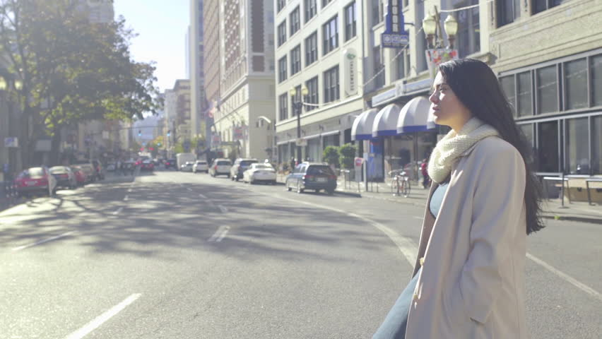 Profile Shot Of Mixed Race Young Woman Crosses The Street In Big City On A Beautiful Day
